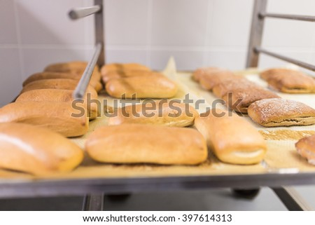 Fresh tasty bread rolls or buns for sale  - stock photo