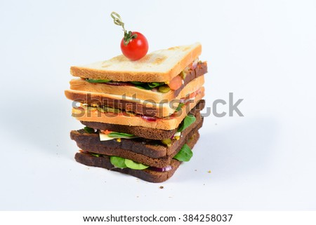 fresh tasty sandwich with ham and greens isolated on white - stock photo