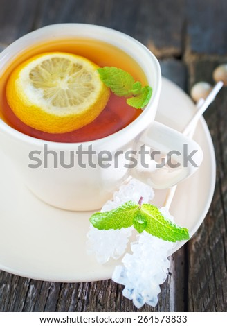 fresh tea with mint and lemon in cup - stock photo