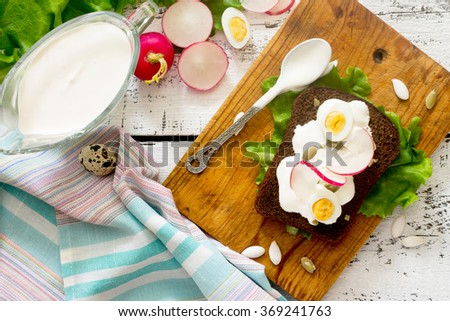 Fresh toast sandwich with egg, radish, pumpkin seeds and sour cream - stock photo