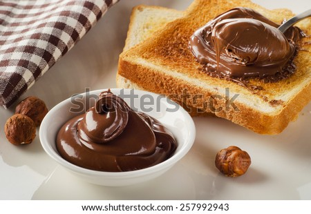 Fresh Toast with sweet chocolate spread for breakfast. - stock photo