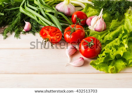 Fresh tomato and garlic, place for text. Healthy eating concept. Vegetarian food. Healthy eating. Ripe vegetables. Fresh vegetables. - stock photo