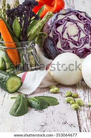 Fresh tomato and Healthy eating fresh vegetables on wood and glass bottle - stock photo