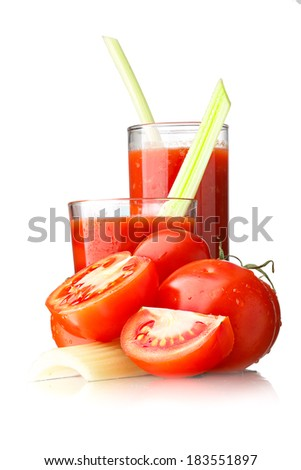 Fresh tomato juice with celery in highball glasses isolated on white - stock photo
