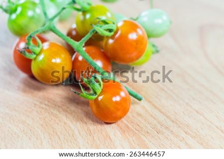 Fresh tomato on wood desk - stock photo