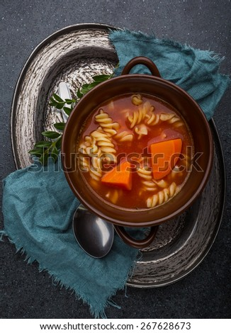 Fresh tomato soup in bowl - stock photo