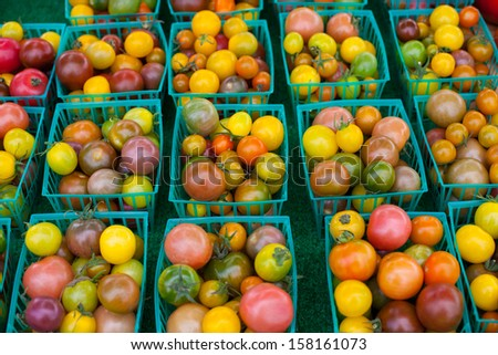 Fresh tomatoes at farmers market - stock photo