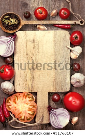 fresh tomatoes, basil, red onion, garlic and black pepper on a cutting board. Vegetarian set of vegetables - stock photo