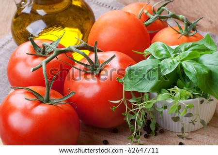 Fresh tomatoes, basil, thyme and olive- still life - stock photo