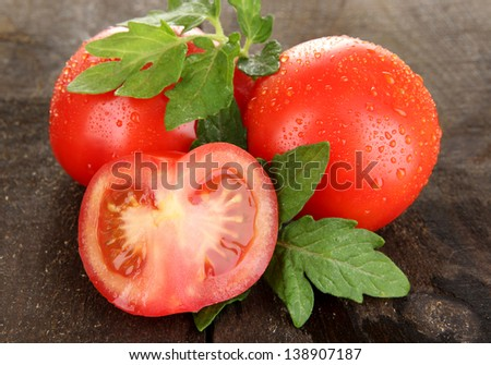 Fresh tomatoes on wooden table close-up - stock photo