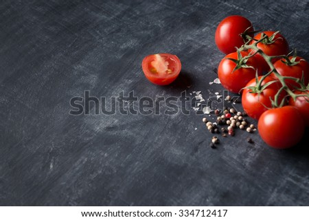 Fresh tomatoes salt and pepper background - stock photo