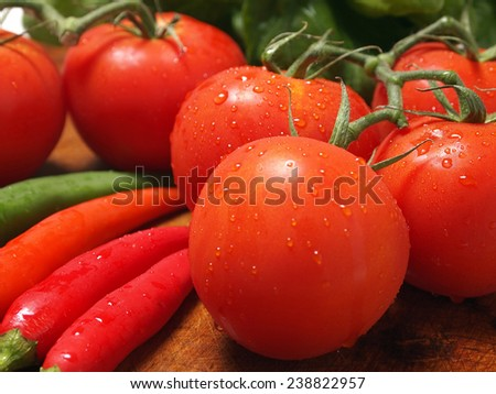 Fresh tomatoes with chili - stock photo