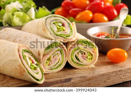 Fresh tortilla wraps with ham cheese and vegetables - stock photo