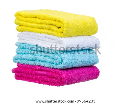 Fresh towels stack general view on white background - stock photo