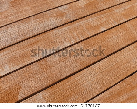fresh treated teak wood - stock photo
