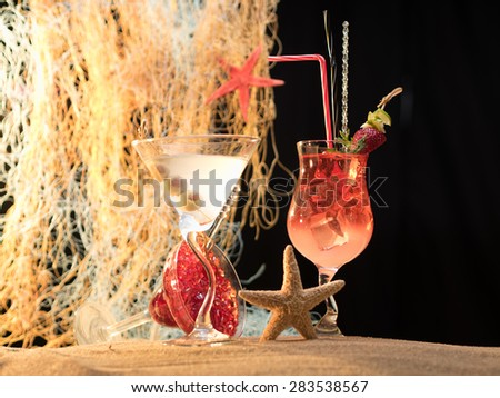 Fresh tropical cocktail the sand at the beach - stock photo