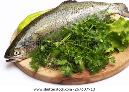Fresh trout on wood cutting board on on white background - stock photo