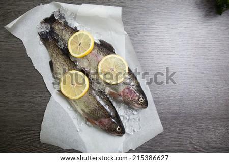 Fresh trout with lemon  - stock photo
