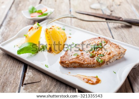 fresh tuna steak grilled served with potato and paprika sauce - stock photo