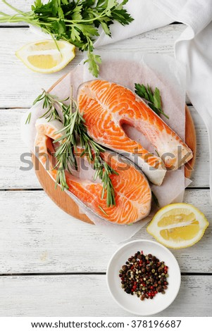 fresh two salmon steak, cooking - stock photo