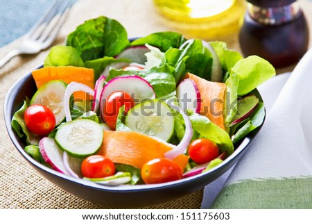 Fresh varieties vegetables salad in a bowl - stock photo