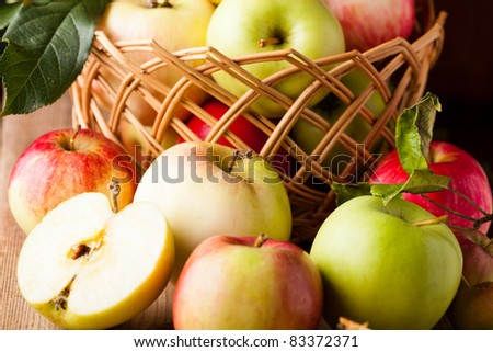 Fresh various apples closeup on wooden table - stock photo