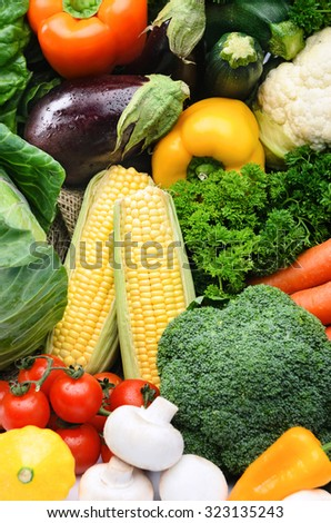 Fresh vegetable background, healthy organic fresh local farmers market, broccoli, sweet corn, parsley, mushroom, tomatoes, squash, aubergine, peppers, capsicums  - stock photo