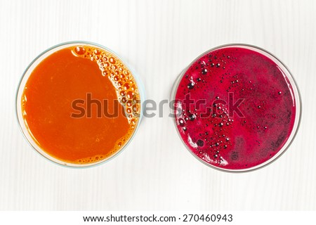 Fresh vegetable juices on wood - stock photo
