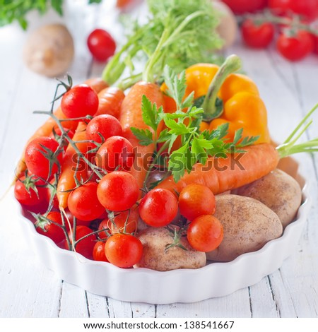 Fresh vegetable on the wooden table, selective focus - stock photo