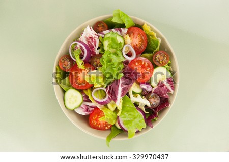 Fresh vegetable salad in a bowl close up - stock photo