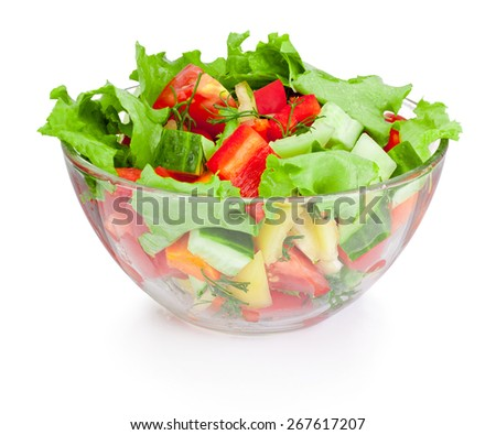 Fresh vegetable salad in glass bowl isolated on white background - stock photo