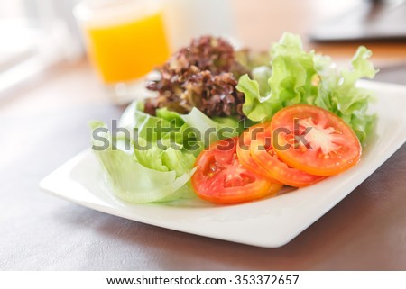 Fresh vegetable salad in plate - stock photo