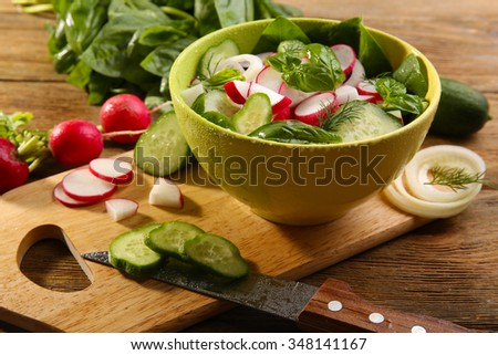 Fresh vegetable salad on table close up - stock photo