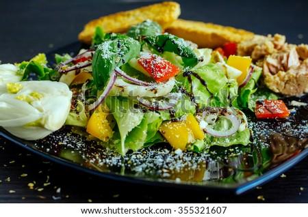 Fresh vegetable salad with bread, tuna and fennel. Italian cuisine. Healthy food. - stock photo