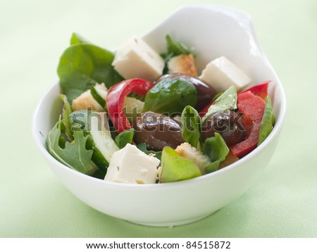 Fresh vegetable salad with calamata olives, crouton and cheese. Selective focus - stock photo