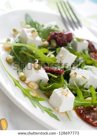 Fresh vegetable salad with cheese, selective focus - stock photo