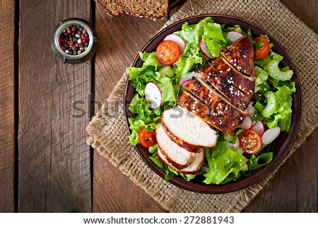 Fresh vegetable salad with grilled  chicken breast. Top view - stock photo