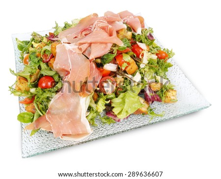 fresh vegetable salad with prosciutto - stock photo
