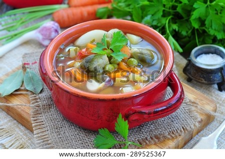 Fresh vegetable soup with bean, carrot, potato, tomato in bowl - stock photo