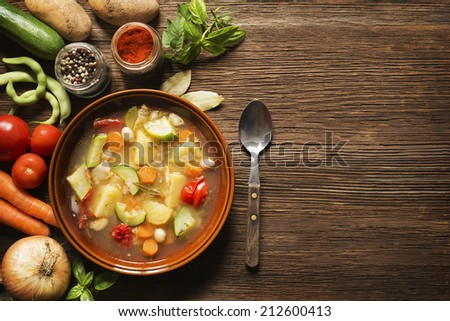 Fresh vegetable stew on wooden background overhead shoot - stock photo