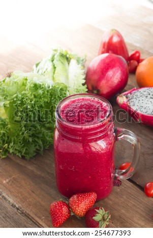Fresh vegetable with fruit on old wood, Healthy drink - stock photo
