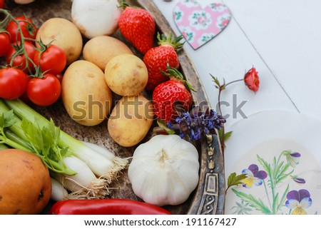 Fresh vegetables and fruits on wooden background - stock photo