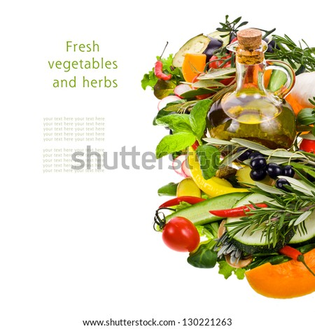fresh vegetables and herbs and small glass bottle of olive oil isolated on a white background with sample text - stock photo