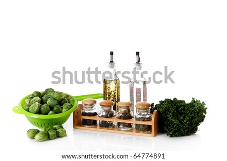 Fresh vegetables and herbs, oil and vinegar. Healthy food. Studio shot. White background. Copy space. - stock photo