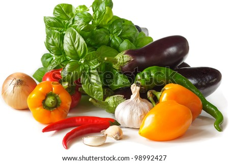 Fresh vegetables and herbs on a white background. - stock photo