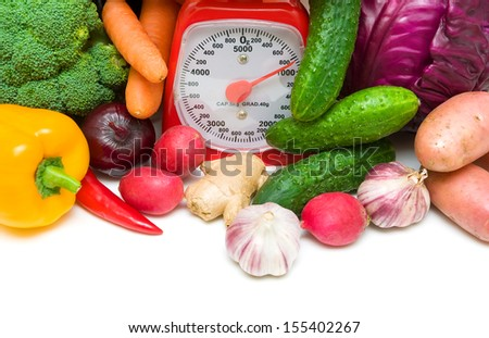 fresh vegetables and kitchen scales close-up. horizontal photo - stock photo