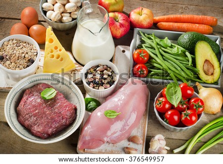 Fresh Vegetables and Meats for Healthy Diet on rustic wooden table.  - stock photo