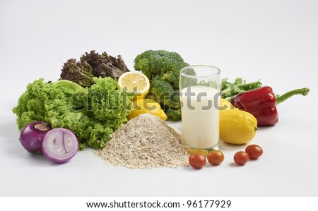 fresh vegetables and milk on white background - stock photo