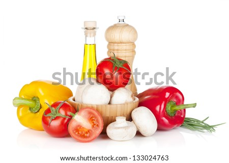Fresh vegetables and mushrooms with olive oil and pepper shaker. Isolated on white background - stock photo