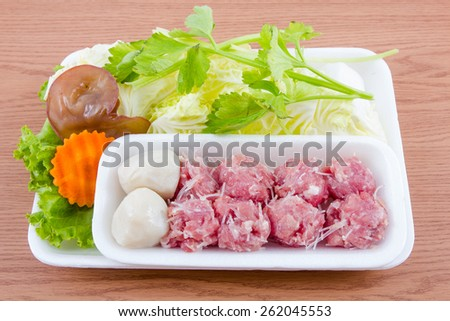 fresh vegetables and pork minced meat on wooden background. - stock photo